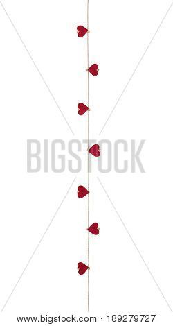 Eight hearts with clothes pegs on a cord, isolated on white