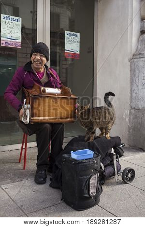 PALERMO ITALY - DECEMBER 20: Man playng music box in the Palermo street on December 20 2016