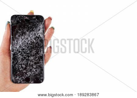 Woman hand holding modern mobile smartphone broken screen and damages. Cellphone crashed and scratch. Device destroyed. Smash gadget need repair. white background