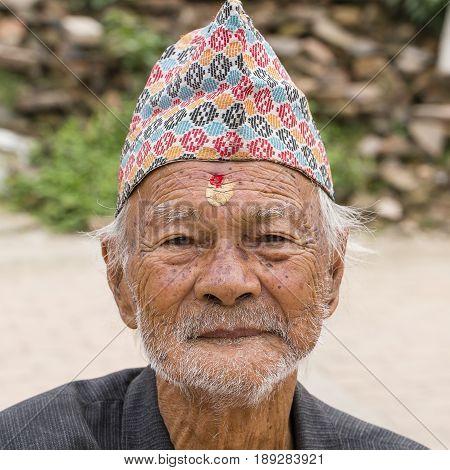 KATHMANDU NEPAL - SEPTEMBER 29 2016 : Portrait old men in traditional dress in street Kathmandu Nepal