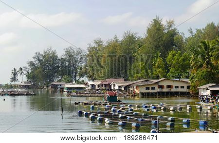 Hat Narathat, Narathiwat, wide view Wide view of fish cages floating in the middle of a lagoon populated by residents in Narathiwat, Thailand