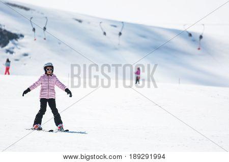 a Beginner little girl learning to ski