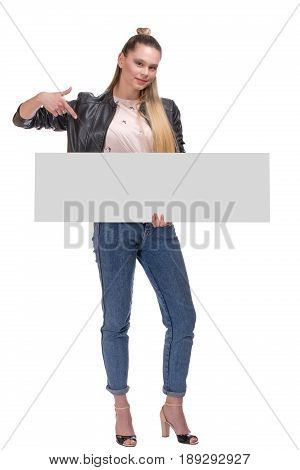 young woman posing with big nameplate isolated on white background