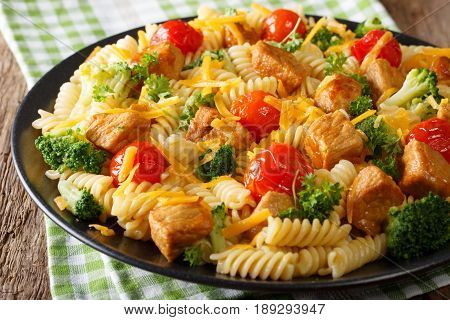 Delicious Food: Italian Pasta With Slices Of Pork, Broccoli, Tomatoes And Cheddar Close-up. Horizont