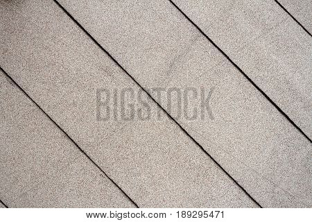 Closeup of lined concrete wall texture. Grungy beige background of lined cement or stone old texture.
