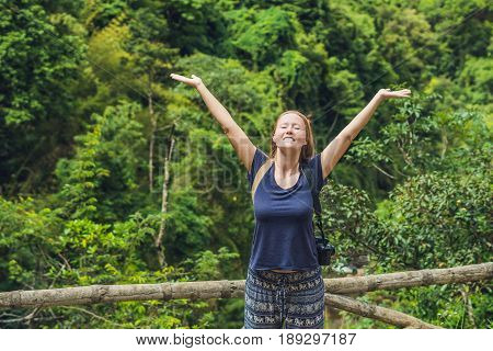 Young Woman Admires The Nature Of Vietnam By Rural Fence