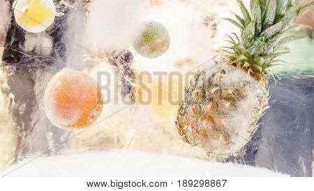 Block Of Ice With Frozen Tropical Fruits