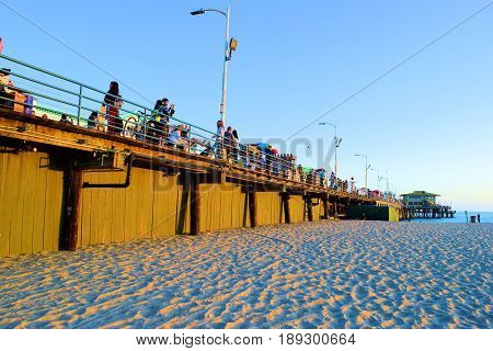 June 1, 2017 in Santa Monica, CA:  People enjoying leisure activities on the historic Santa Monica Pier built in 1909 where the public can enjoy restaurants, retail stores, and Amusement Rides taken in Santa Monica, CA