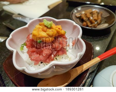 Uni or Sea Urchin Served on top of Raw Fish and Sushi Rice in Small Portion