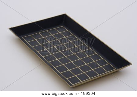 a scientific picking tray used to count samples under a microscope in order to complete research. poster