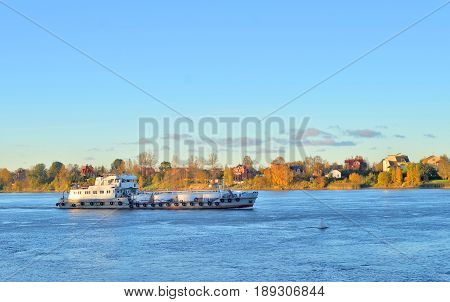 Cargo ship on Neva river at evening outskirts of St.Petersburg Russia.