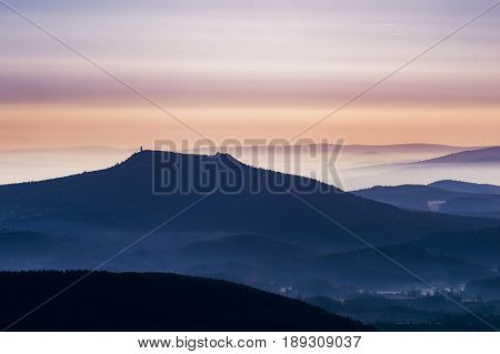 Morning foggy landscape and peak of Hvozd in northern Bohemia on aerial photography.