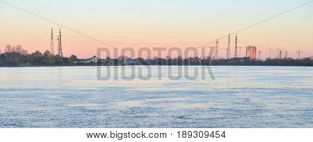 View of Neva river at sunset outskirts of St.Petersburg Russia.