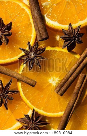 anise star cinnamon Orange half of orange orange lobule. overhead view