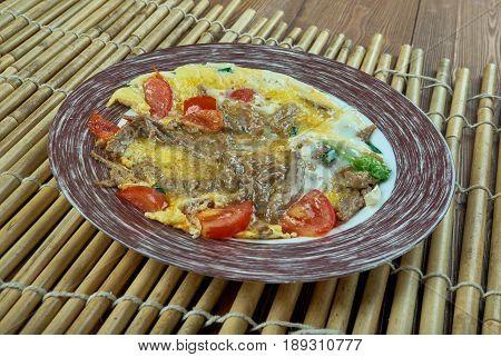 Machacado con huevo. Mexican cuisine. close up
