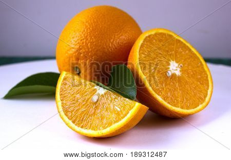 Orange fruit. Orange slices, half orange, whole orange, orange background