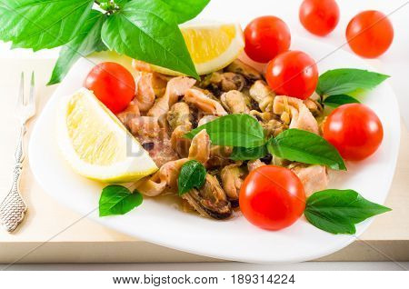 Mussels, Squid And Octopus, Decorated With Greens