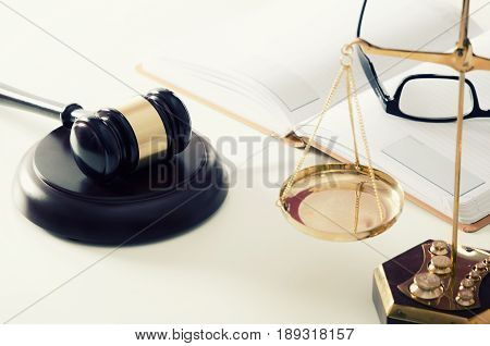 Law scale justice with gavel in background. law scale attorney justice legal courtroom gavel eyeglasses concept