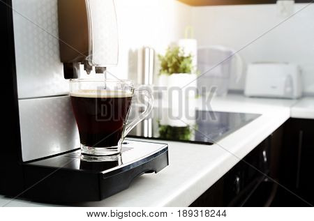 Black Coffee In Glass From Coffee Maker Machine