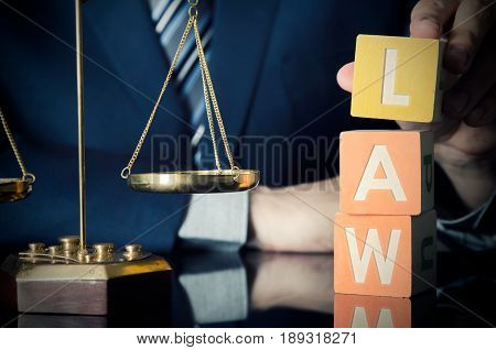 The Lawyer Puts Law Word. Attorney And Lawyer Concept
