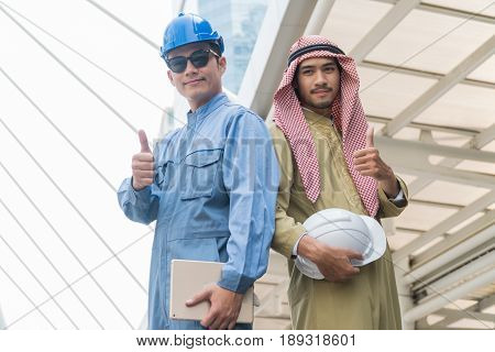Arab businessmen and Smart foreman standing Thumbs up with in modern city