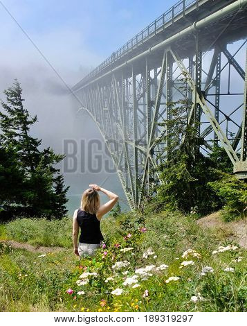 Happy women hiking by ocean in foggy morning. Deception Pass Bridge Park. Seattle. Anacortes. Washington. United States.