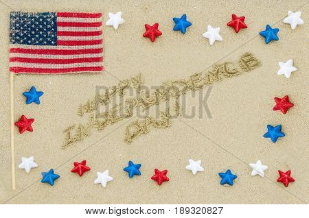 Independence USA background with stars and American flag on the sandy beach near ocean