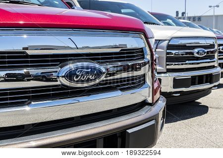 Lafayette - Circa June 2017: A Local Ford Car and Truck Dealership. Ford sells products under the Lincoln and Motorcraft brands IX
