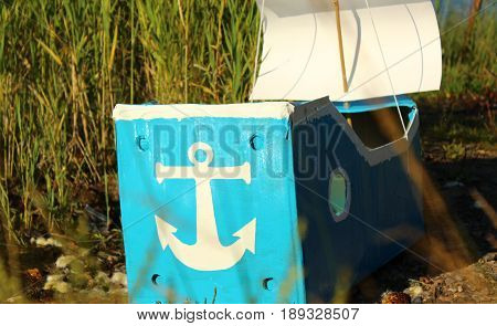 Painted anchor on a ship made of cardboard