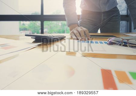 Business Man Do Turnover Graph Chart Financial Paper Of Company And Laptop Computer On Wooden Desk I