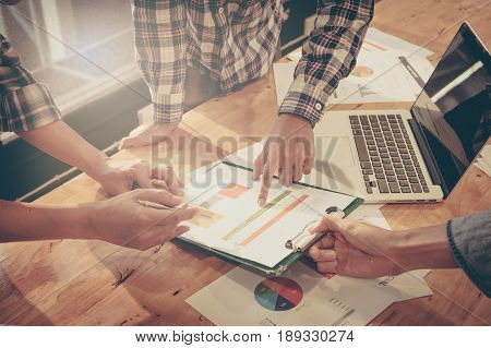 Business People Hands At Working With Financial Plan And On Wooden Desk In Office, Top View Shot. Gr