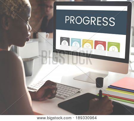 African woman working using computer screen and mousepad
