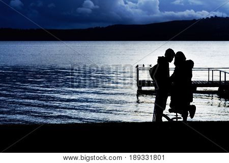 Silhouette sweet young couple at Lake Taupo in the evening North Island of New Zealand
