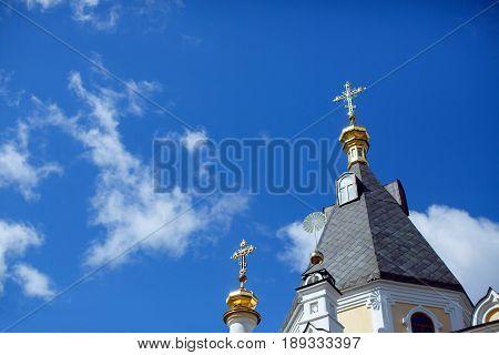 golden crosses of the Christian church against the blue sky