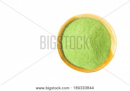 Closeup top view green matcha tea powder in bowl isolated on white background with clipping path