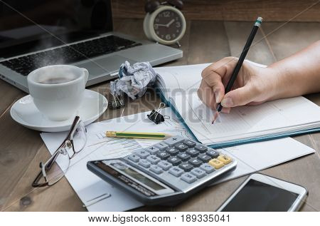 Business Woman Writing On Calendar Note On Work Table