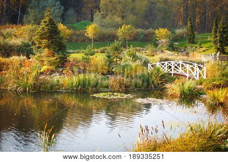 loneliness landscape design of country residence with a white bridge across the lake