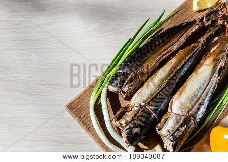 fish mackerel on wooden hardboard on wooden table
