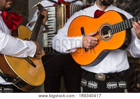 Mexican musicians in the studio, in the interior. Mexico, mariachi, artist, guitarist.