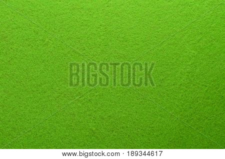 Green Felt Texture Background. Fiber texture of felt close-up