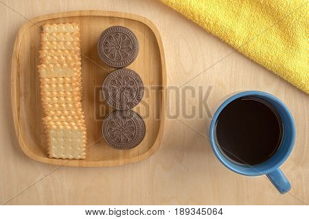 Biscuit Cracker On Wooden Plate With A Cup