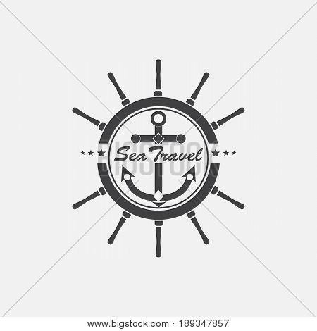 Marine steering wheel and a anchor in the center. The emblem on the marine theme.