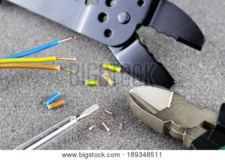 An image of electro cable, tools, repair