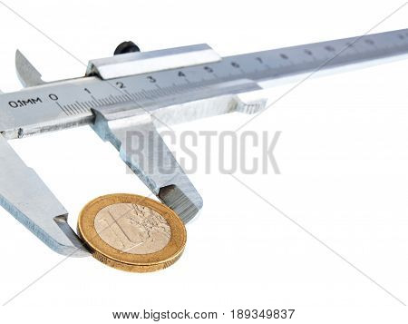 Isolated vernier caliper with a coin on white background