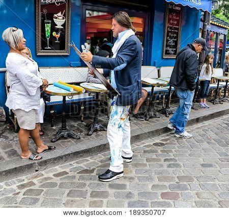 PARIS, FRANCE-JULY, 2016: Montmartre Street Painters, colorful and famous Place du Tertre