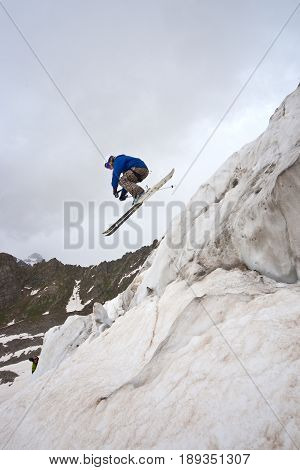 Freerider, jumping in a mountains, Caucasus, summer, 2010