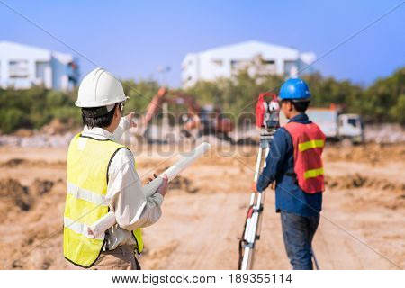 Construction Engineer With Foreman Worker Checking Construction Site For New Infrastructure Construc