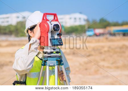 Asian Construction Engineer Checking Construction Site For New Infrastructure Project. Photo Concept