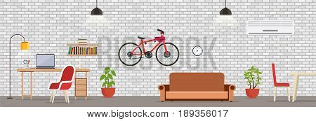 Interior room with white brick wall. Modern room for work and leisure with a table a laptop chair lamp lighting shelf with bicycles sofa and air conditioning.