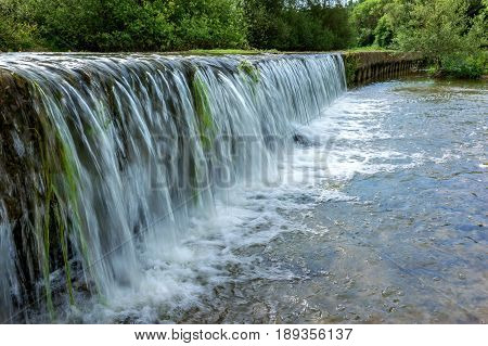 French countryside. A small waterfall on the banks of the Meuse in the south of Lorraine